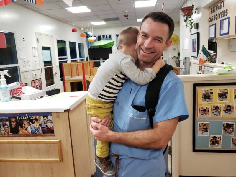 Dr. Jonathan Bradley picks up his 22-month-old son Leo from Palcare Childcare in Burlingame, CA