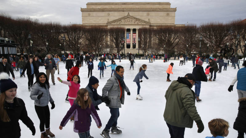 People skate on the National Gallery of Art Sculpture Garden Ice Rink on Thursday, Dec. 27, 2018, as a partial government shutdown continues in Washington. The museum and the skate rink will be closed to the public after Jan. 2 as a result of the shutdown if it continues into the new year.