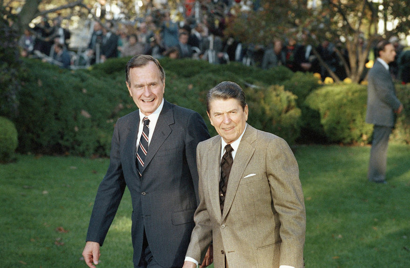 President Ronald Reagan (right) greets President-elect George H.W. Bush upon his arrival at the White House on Nov. 10, 1988.