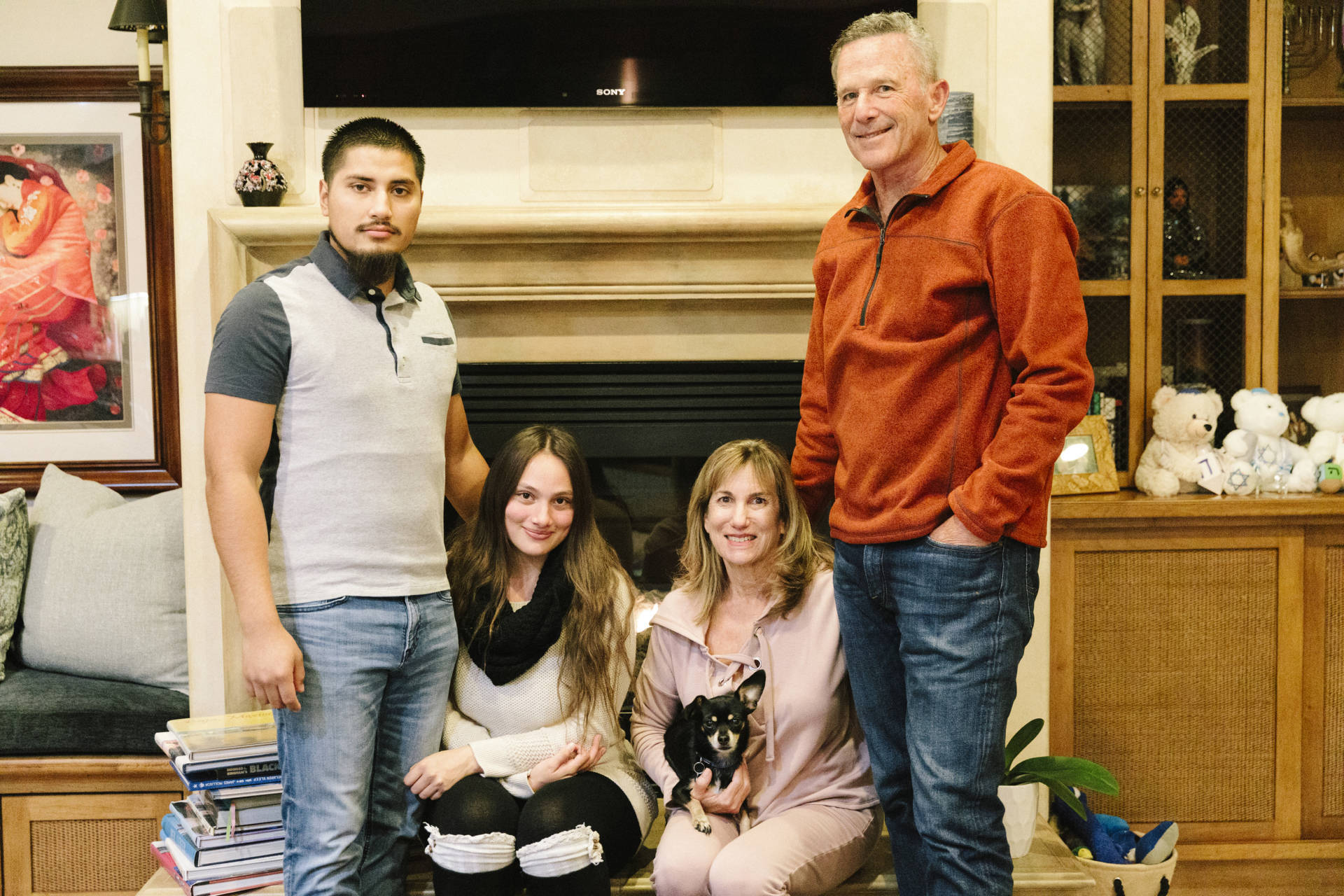 """Bryan and Helen Lopez (left) had been living in their car before they moved in with Marlene and Michael Rapkin in September. As part of Host Home Program in Los Angeles, the plan was to stay with the Rapkins for about three months, but they are staying longer. """"We're open to extend it as long as they're committed to doing what they're doing, which they are,"""" Marlene says. Liz Kuball/NPR"""