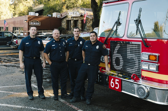 "Los Angeles County firefighters, from left: Brian Knutson, Jay Colvin, Adam Young and Marcus Carballo. Knutson lives in the community and says this is the worst fire any of them can ever remember. ""It's always hard to talk to someone that's lost their house,"" he says. ""I wish we could have done more for them."""