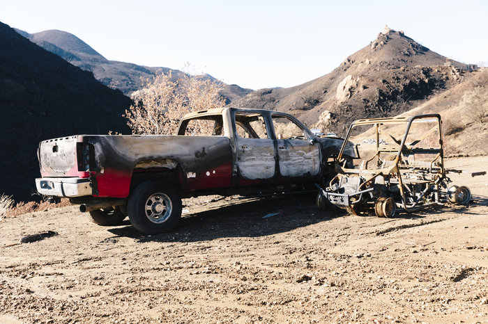 A few of the burned-out vehicles on Jones' property. The truck he used to escape during the fire is heavily blistered by fire, but still intact.