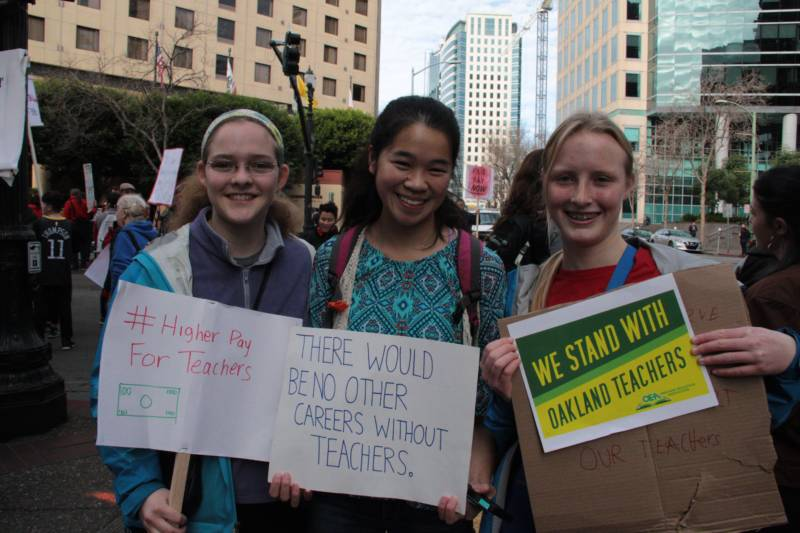Oakland Technical High School students Percy Unger, Caitlin Lee and Josie Goodson (L-R) joined in the teacher walkout and rally, Jan. 18, 2019
