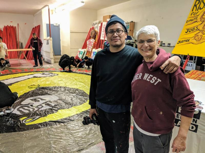 (L-R) Claudio Martinez and Kim Cosier are both artists involved with the collective Art Build Workers in Milwaukee, Wisconsin. They came to Oakland to support the 'art build' event.