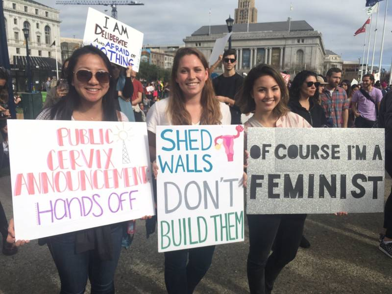 Erica Yarborough, Shannon McCarty, and Sheryl Fuehrer are Stanford students at the San Francisco Women's March. Fuehrer is thinking about the government shutdown: 'I think it's extremely sad and really goes against what both Republicans and Democrats want to see in our country right now.'