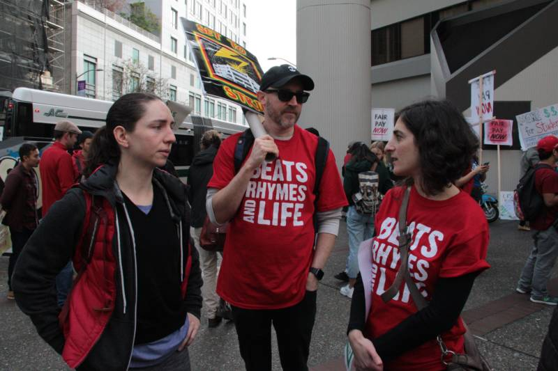Oakland High School teachers Roxanne Clement, Payton Carter and Jessica Ford (L-R) marched to Oakland Unified School District's headquarters in downtown Oakland. Ford said she'd like to see the prosperity of many parts of the Bay Area be reflected in school budgets.