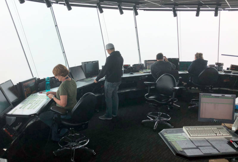 Air traffic controllers at work inside SFO's control tower.