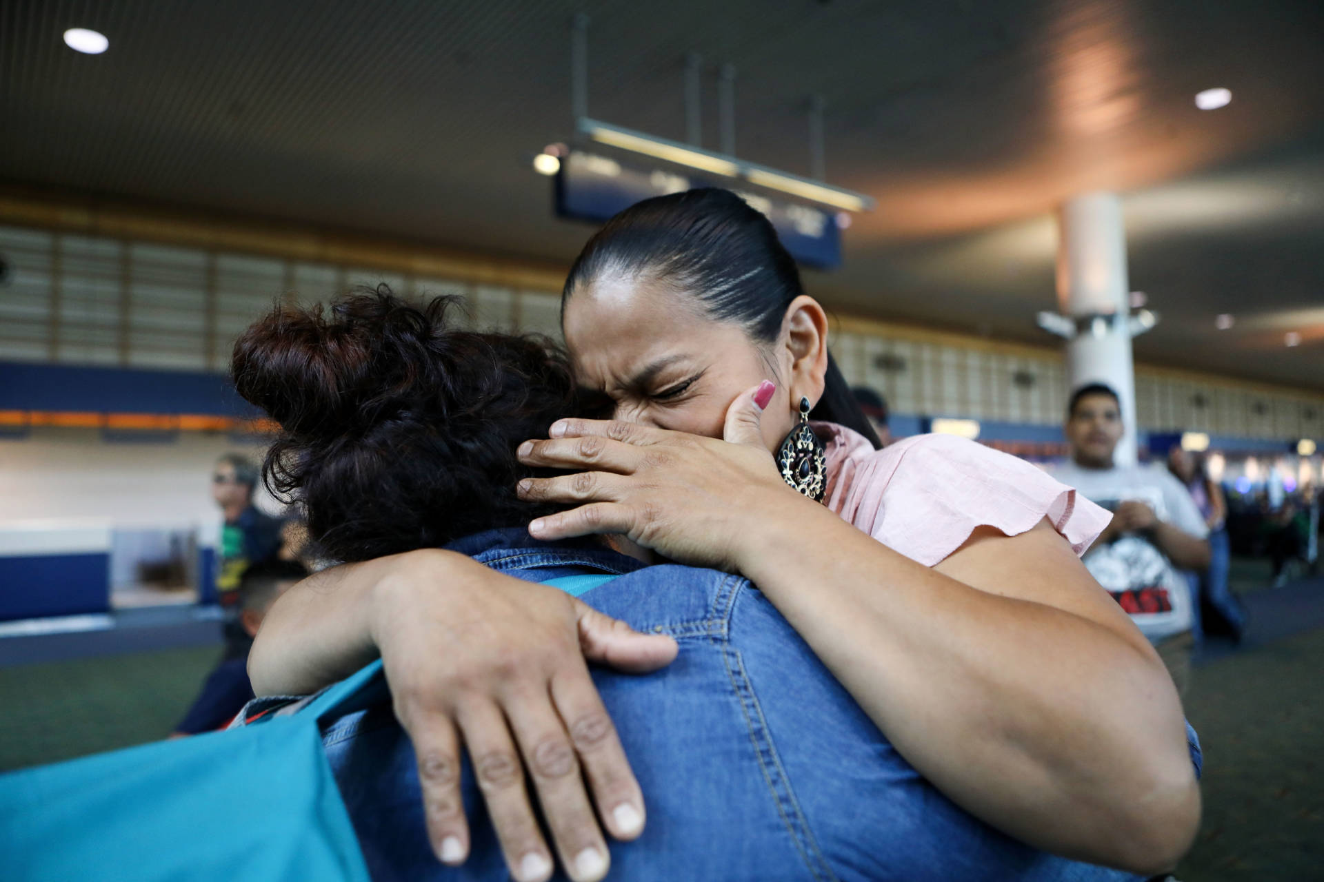 An immigrant who identified herself only as Vioney (L), was released after spending six months in an ICE detention facility. She hugged her sister Yadira while being reunited with family on Sept. 2, 2018, in Oregon. Vioney, originally from Mexico, crossed the San Ysidro Port of Entry with three of her children in February, and asked for asylum. She was separated from her three children the same day and held in detention in California until August 31. Her children, who are U.S. citizens, were immediately freed. A group of mothers known as Immigrant Families Together posted her bond, and she will remain in the country with her family while her case is adjudicated.  Mario Tama/Getty Images