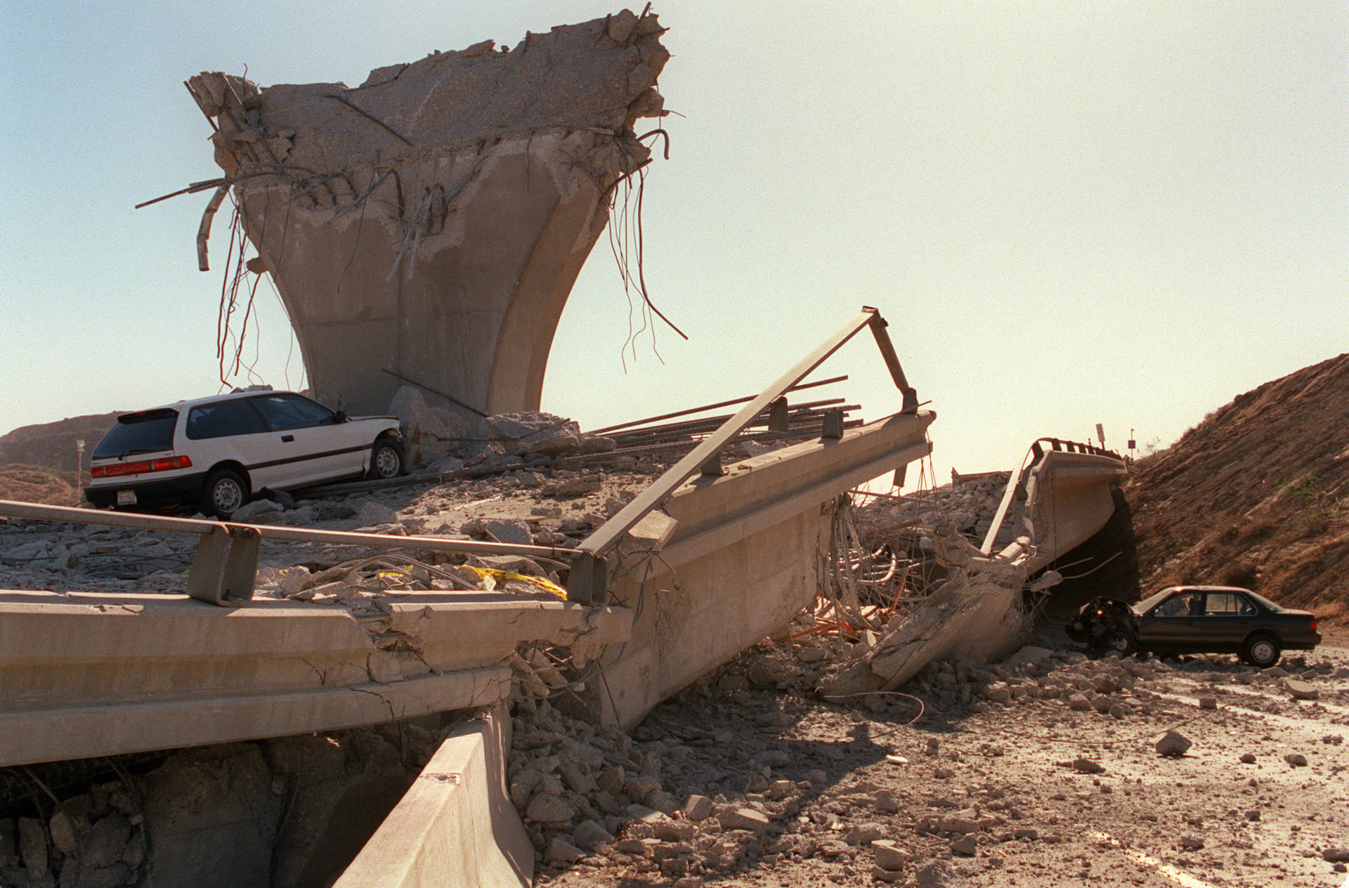 Cars lie smashed by the collapsed Interstate 5 connector few hours after Northridge earthquake, on January 17, 1994, in Sylmar, California. Jonathan Nourak/AFP/Getty Images