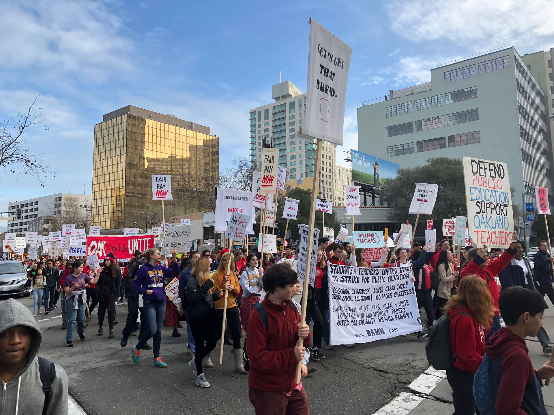 Hundreds of Oakland teachers, students and supporters, frustrated over an impasse in contract negotiations with the school district, gathered outside Oakland Technical High School and then marched in a walkout on Jan. 18, 2019. Ryan Levi/KQED