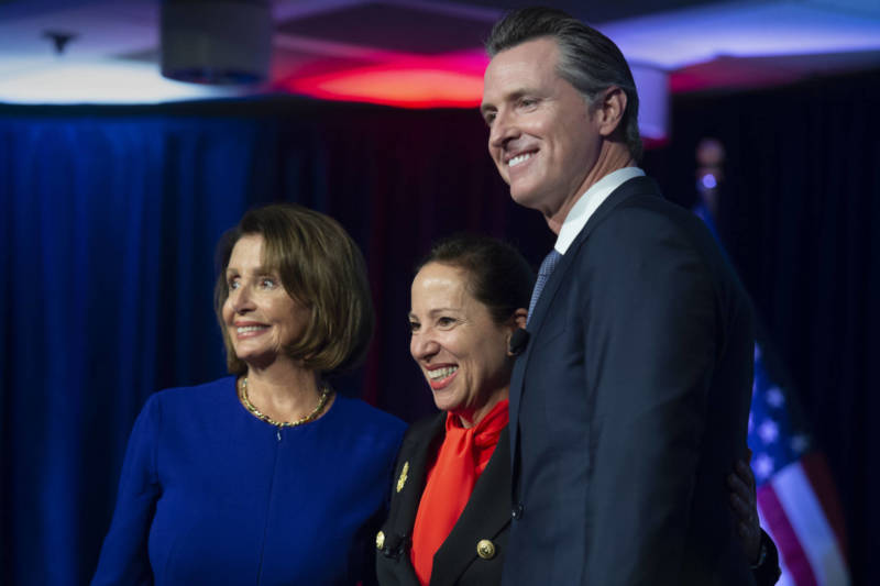 Congresswoman Nancy Pelosi, Lt. Gov. Eleni Kounalakis and Gov. Gavin Newsom stand together on stage at the Tsakopoulos Library Galleria on Monday, January 7, 2019 in Sacramento.