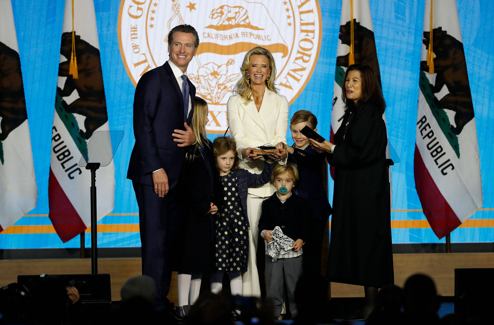Gavin Newsom is sworn in as governor of California by California Chief Justice Tani Cantil-Sakauye (R), as Newsom's wife, Jennifer Siebel Newsom (C), watches on Jan. 7, 2019, in Sacramento. Stephen Lam/Getty Images