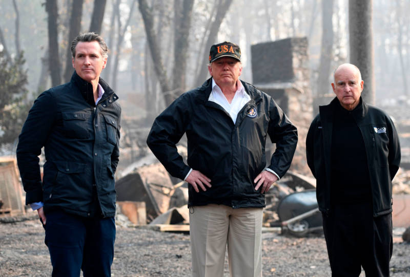 Then-Lt. Gov. Gavin Newsom, President Trump and then-Gov. Jerry Brown view devastation caused by the Camp Fire in Paradise on Nov. 17, 2018.