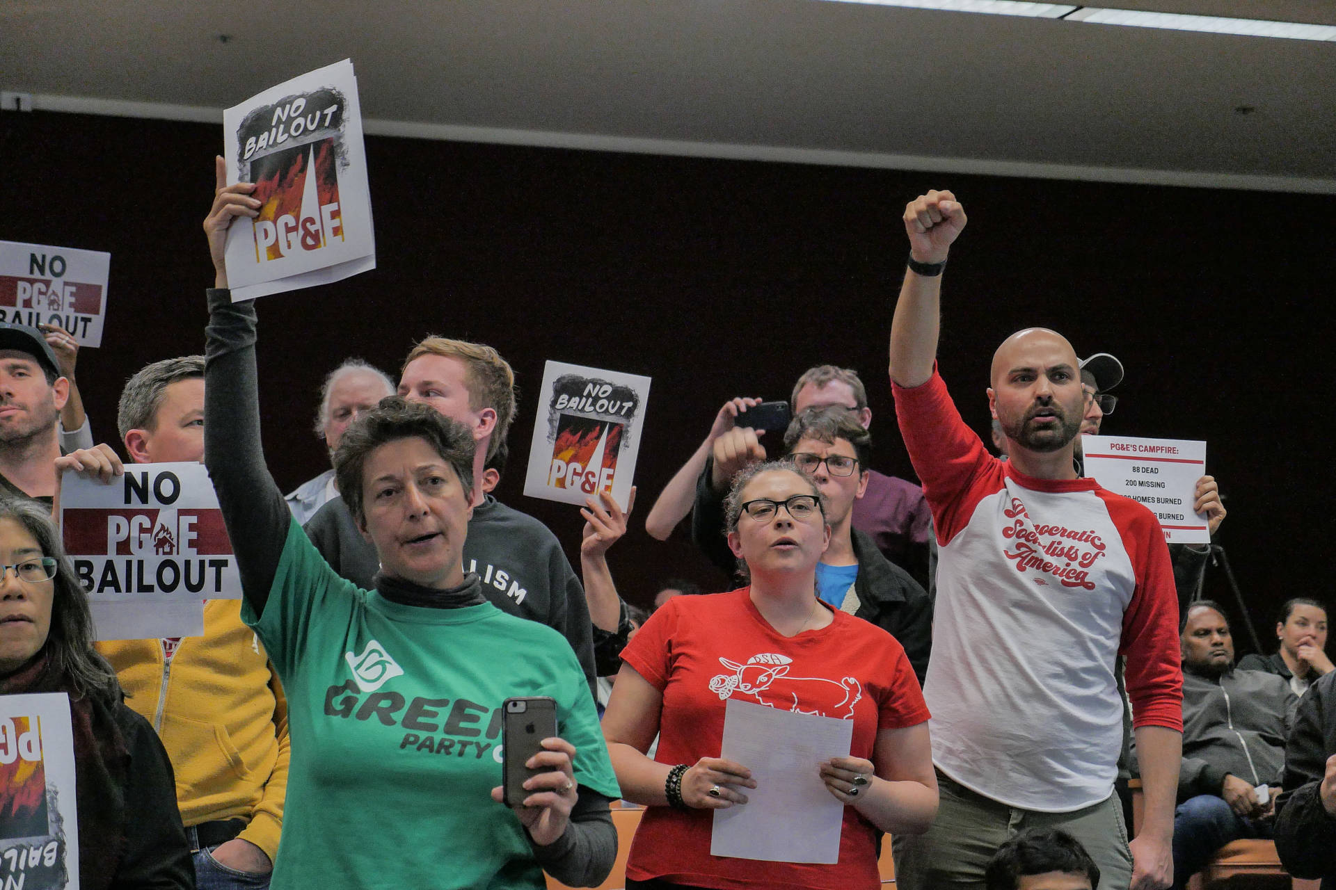 Activists from the No PG&E Bailout coalition protest at the end of an emergency CPUC meeting on Jan. 28, 2019. Sheraz Sadiq/KQED