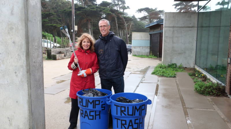 Reps. Jackie Speier and Jared Huffman stand with trash collected at Lands End and Ocean Beach on Jan. 5, 2018, during the government shutdown. They say the will be delivering the trash to President Trump.