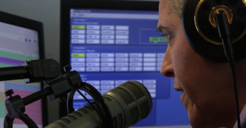 Julie Deppish, KQED's evening traffic reporter, reads from a monitor at the Total Traffic & Weather Network office.