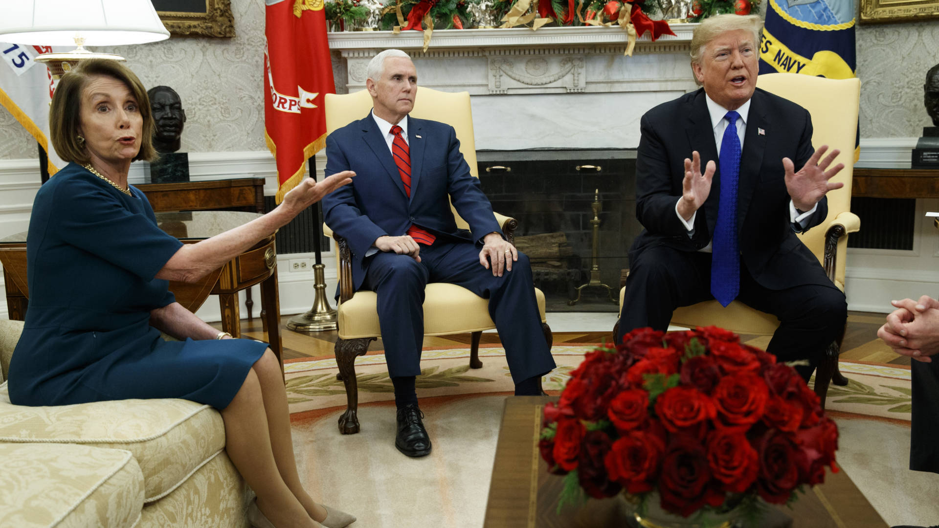 Vice President Mike Pence, looks on as now-House Speaker Nancy Pelosi argues with President Trump during a meeting in the Oval Office last month. Evan Vucci/AP