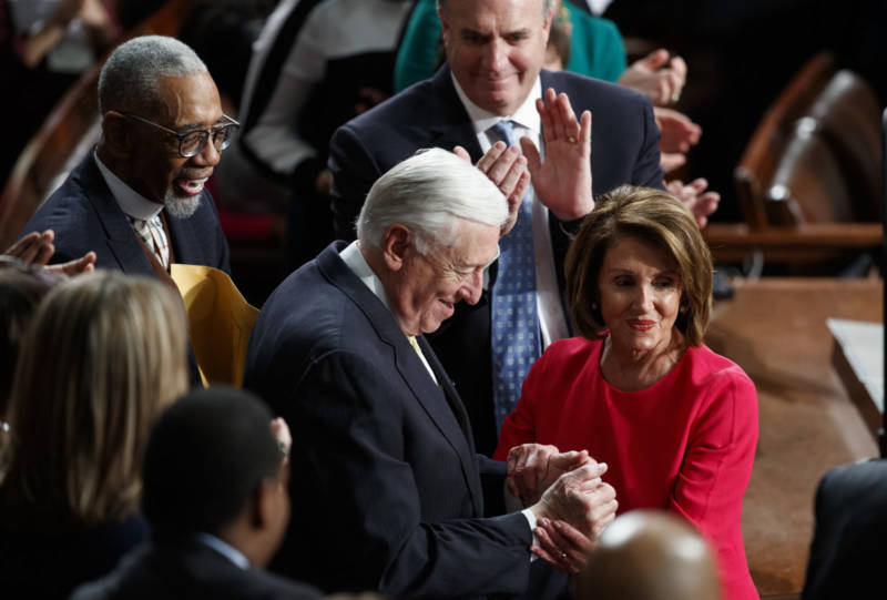 New Speaker of the House Nancy Pelosi and Steny Hoyer, D-Md., are applauded at the Capitol on Thursday as Democrats officially regain control of the chamber.