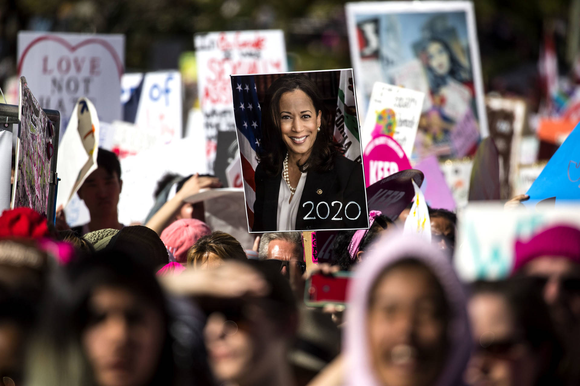 A person holds a poster of California U.S. Sen. Kamala Harris with '2020' written on it at the Women's March in Los Angeles on Jan. 19, 2019. Harris announced her candidacy for president on Monday, January 21, 2019. Barbara Davidson/Getty Images