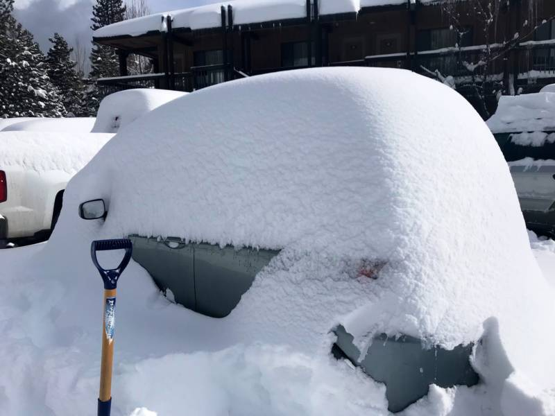 A Toyota Yaris buried by snow on Lake Tahoe Boulevard.
