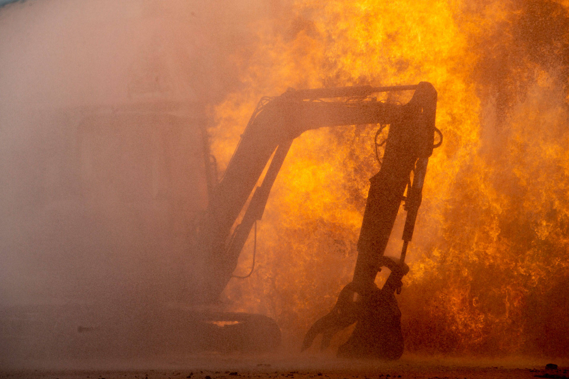 Construction equipment catches fire from a blaze following an explosion of a gas line on Feb. 6, 2019 in San Francisco's Richmond District. Santiago Mejia-Pool/Getty Images