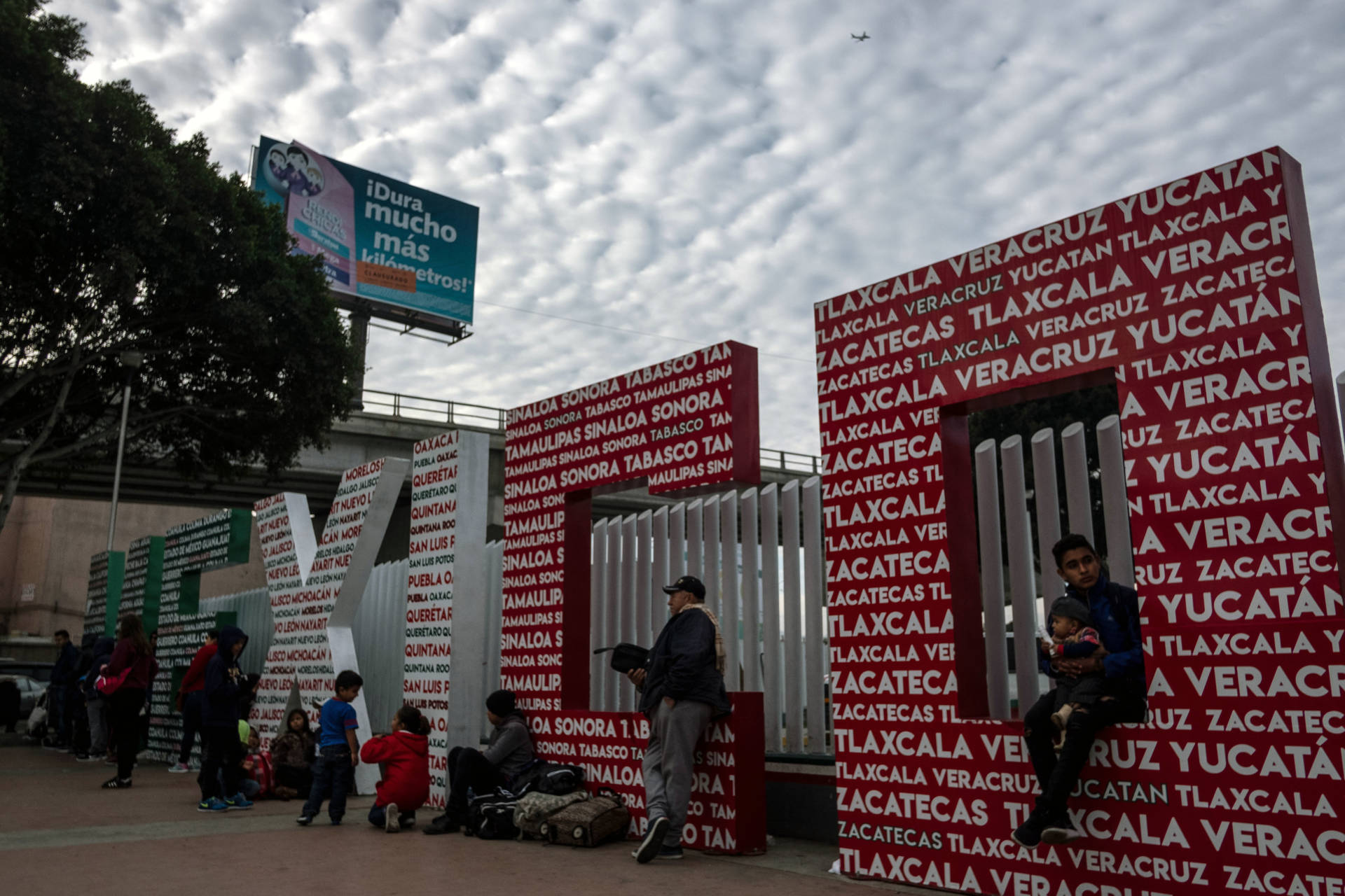 Asylum seekers wait at El Chaparral crossing port at the US-Mexico border, in Tijuana, Baja California state, Mexico, on January 29, 2019. GUILLERMO ARIAS/AFP/Getty Images