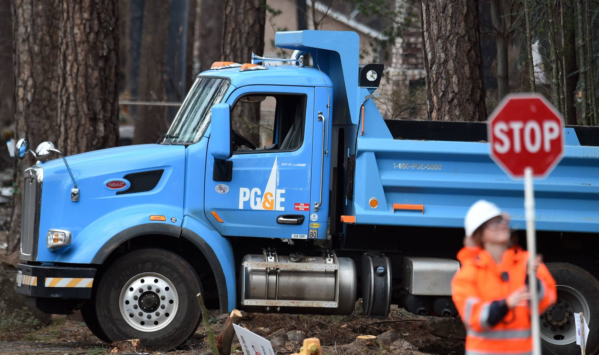PG&E crews worked in early February to restore utility service in Paradise, mostly destroyed by last November's Camp Fire.  Josh Edelson/AFP-Getty Images
