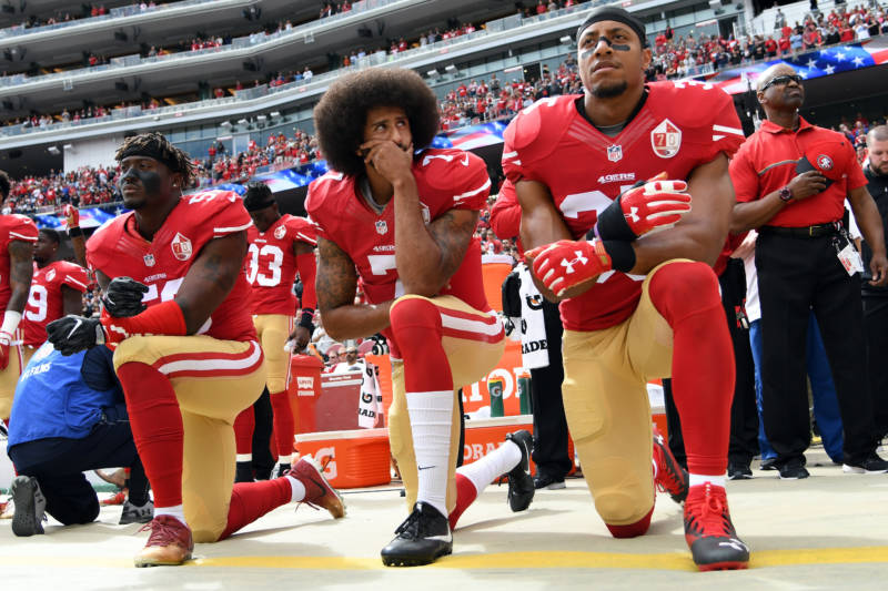 NFL Settles With Kaepernick, Reid in Collusion Case Tied to Kneeling During Anthem
