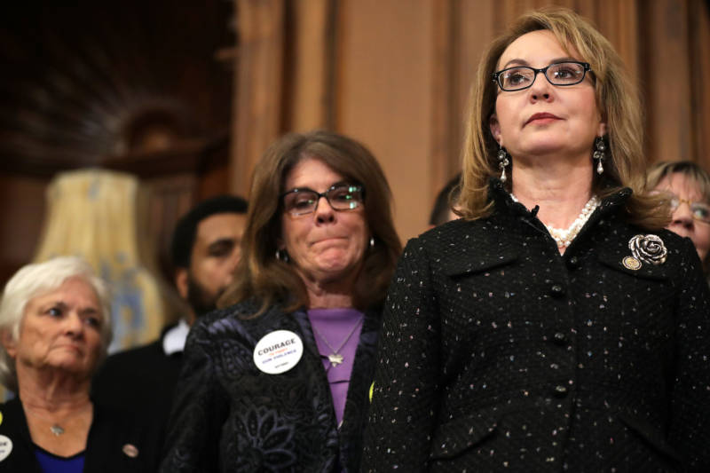 Former Arizona Congresswoman Gabby Giffords (R) joins other gun violence survivors and safety advocates at a news conference to introduce legislation to expand background checks for firearm sales on Jan. 08, 2019.