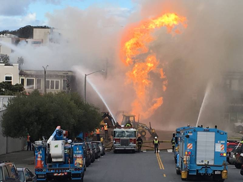 Crews from PG&E and the San Francisco Fire Department at the scene of a natural gas blast and fire on Geary Boulevard in the city's Inner Richmond neighborhood.