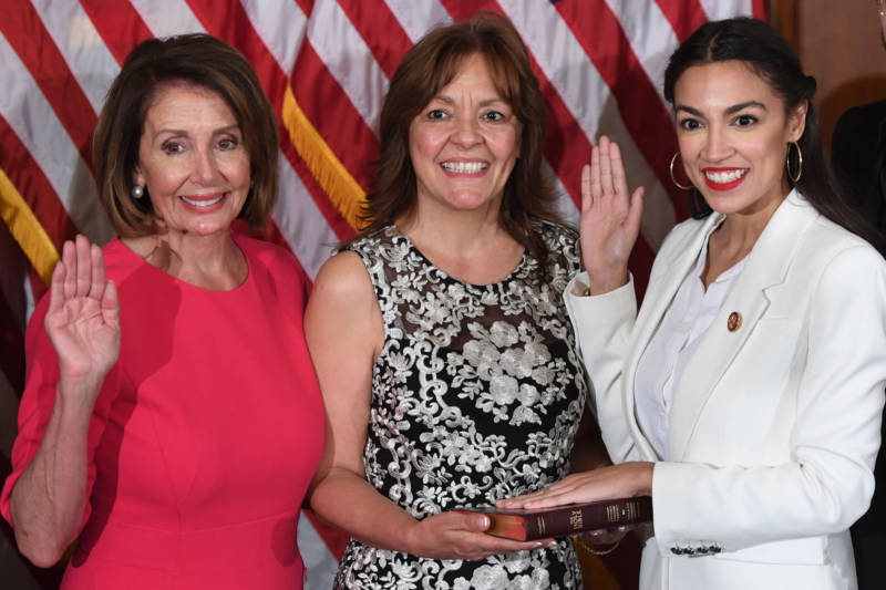 Speaker Nancy Pelosi performs Rep. Alexandria Ocasio-Cortez's (right) swearing-in on Jan. 3, 2019.
