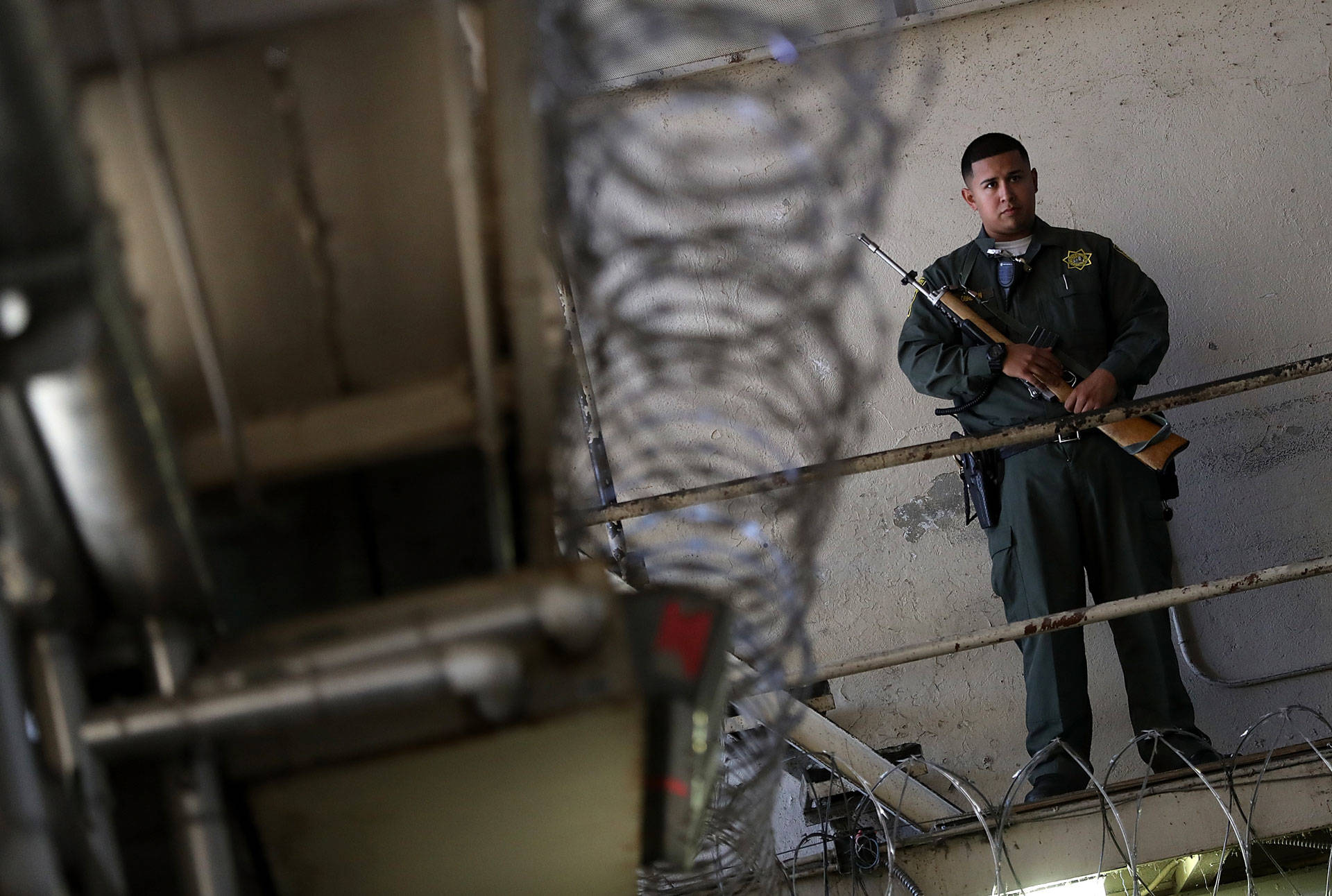 An armed California Department of Corrections and Rehabilitation (CDCR) officer stands guard at San Quentin State Prison in 2016. Justin Sullivan/Getty Images