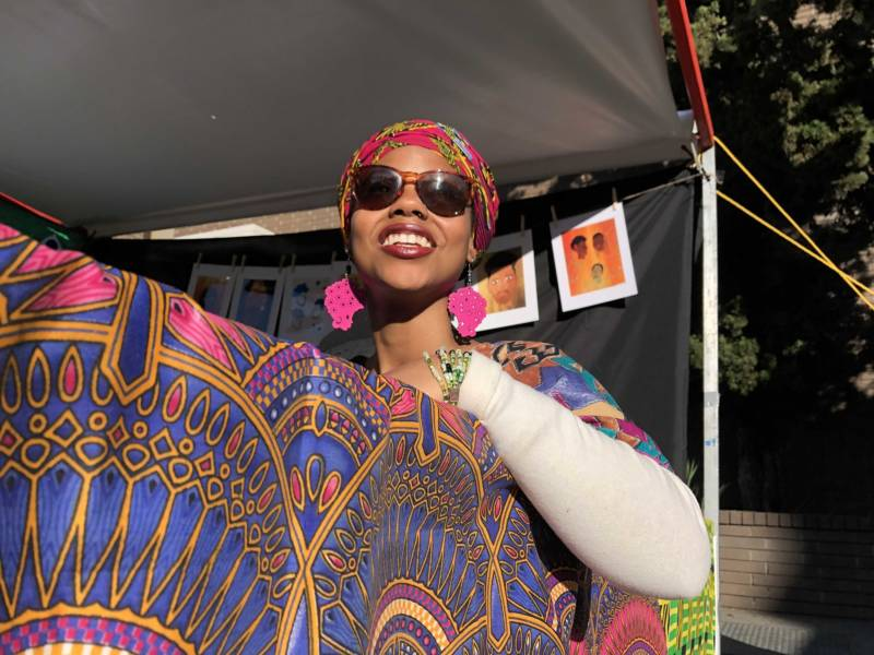 Tiana Dorley helps artists friends at the Black Joy Festival in Oakland.