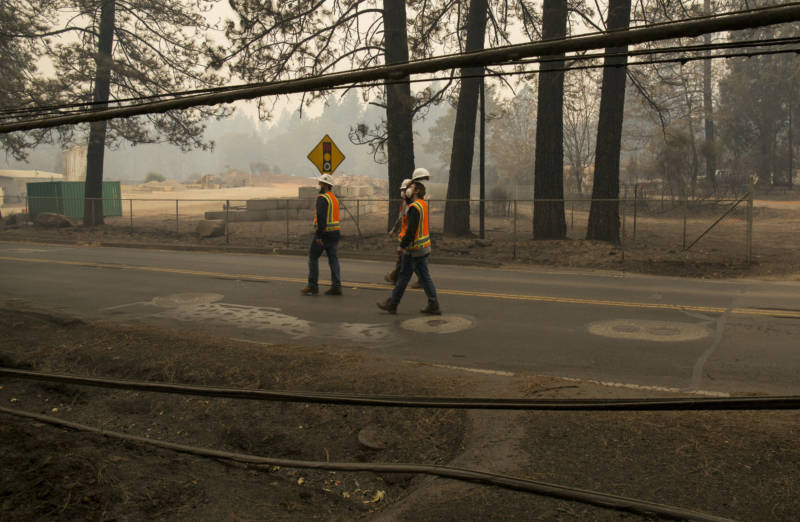PG&E subcontractors walk along Skyway to assess vegetation at risk for catching fire on November 13, 2018.