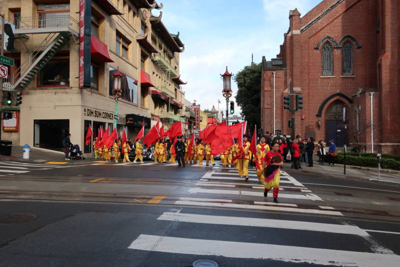 Performers get in position for their march down California Street in San Francisco's Chinatown.