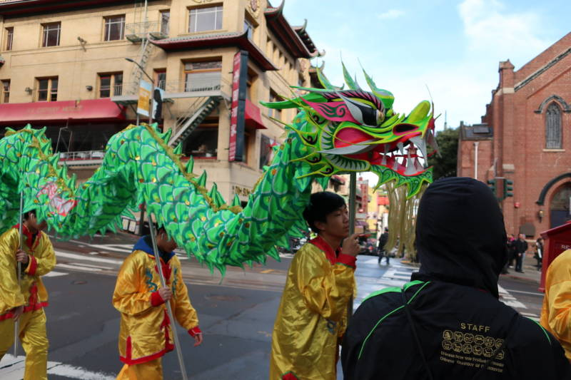 Performers prepare to take part in the procession during the Lunar New Year kickoff event in San Francisco's Chinatown.