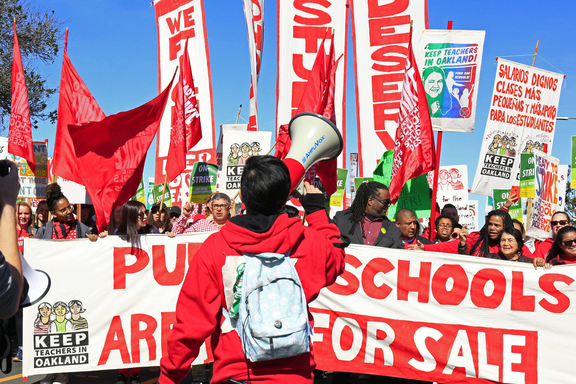 Oakland teachers, joined by student supporters, march down Adeline Street in West Oakland on Feb. 22, 2019, the second day of a districtwide teachers strike.   Stephanie Lister/KQED