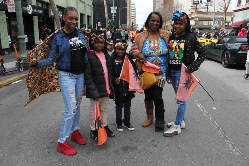 "Grandma Vickie Goins of Oakland brought her granddaughters to the parade: Constance Capers, Kaliyah Capers, Lamariah Hayes, and Emerald Capers. ""I grew up in an atmosphere of black empowerment,"" Goins said. ""My aunt was a Black Panther."""