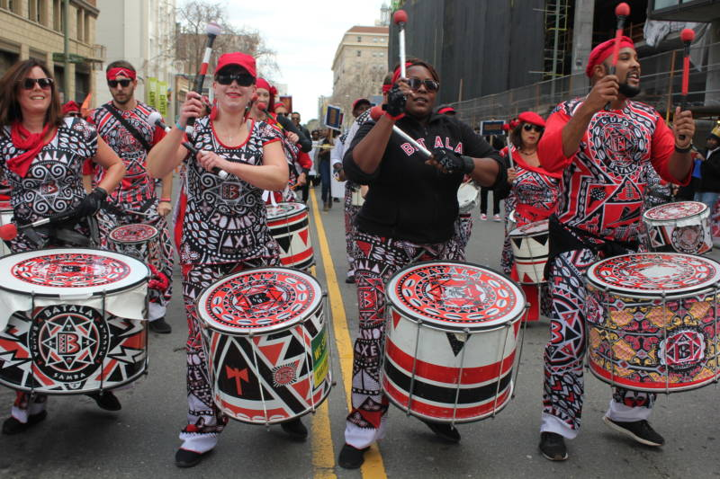 A drum group performs during the Black Joy Parade in downtown Oakland.