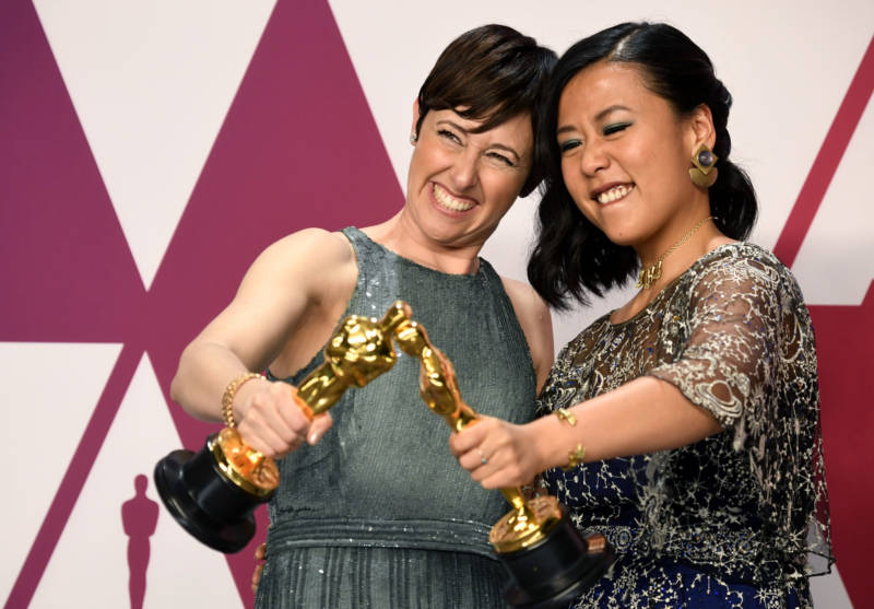 "Becky Neiman-Cobb (L) and Domee Shi, winners of Best Animated Short Film for ""Bao,"" pose in the press room during the 91st Annual Academy Awards at Hollywood and Highland on February 24, 2019 in Hollywood, California."