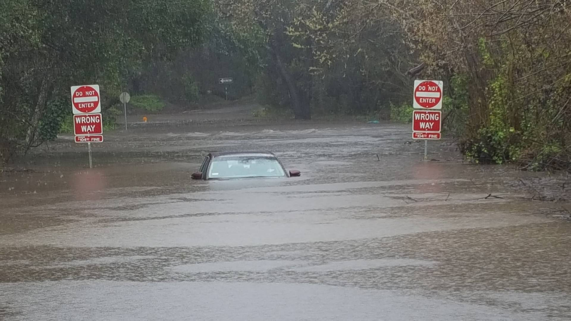 A car was submerged Wednesday in  floodwaters from Arana Creek in Santa Cruz.  California Highway Patrol