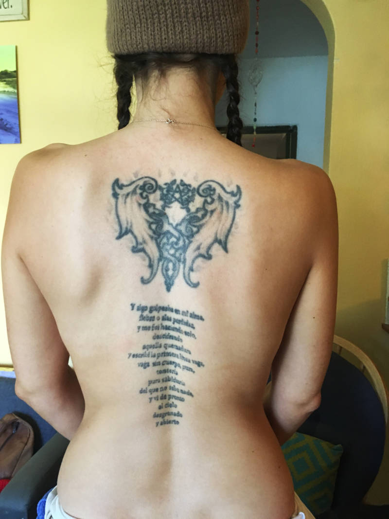 The tattoo on Erin's back which inspired her teacher's love poem