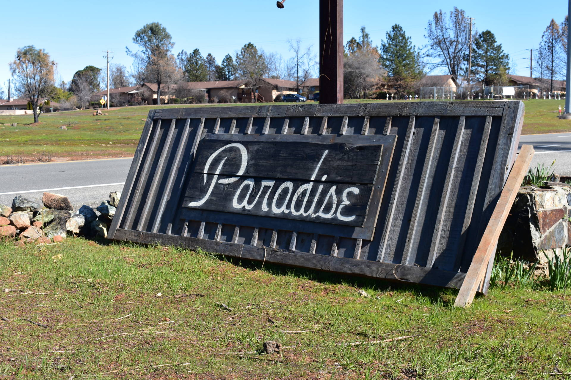 A makeshift sign welcoming drivers to Paradise sits along Skyway. Jeremy Siegel/KQED