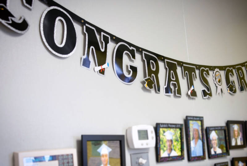A bulletin board displays graduates of Rudsdale Newcomer High School in the building's main office.