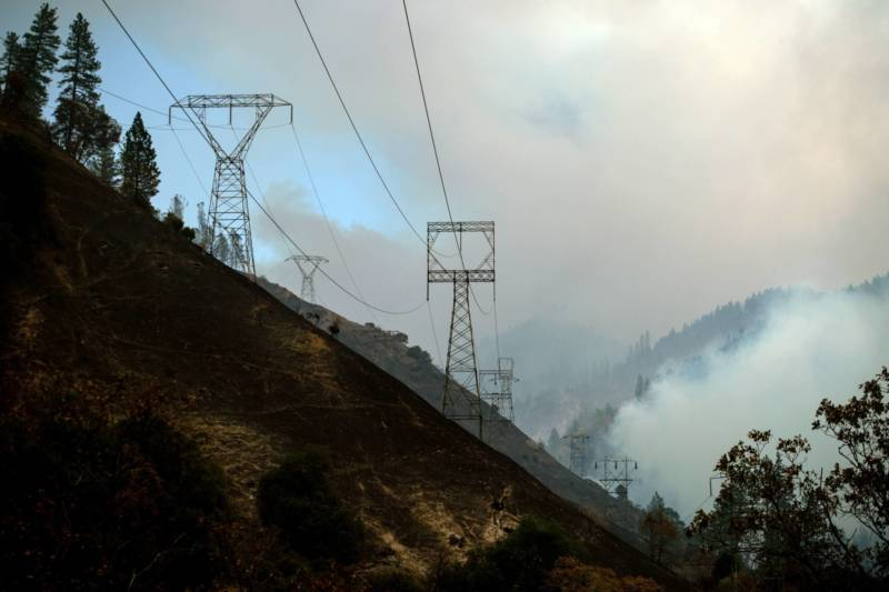"PG&E transmission line towers on the Caribou-Palermo line are seen adjacent to the Feather River in Butte County, close to the spot where officials say the Camp Fire began. In February, PG&E said it's ""probable"" that its equipment caused the blaze, the deadliest and most destructive in modern California history."