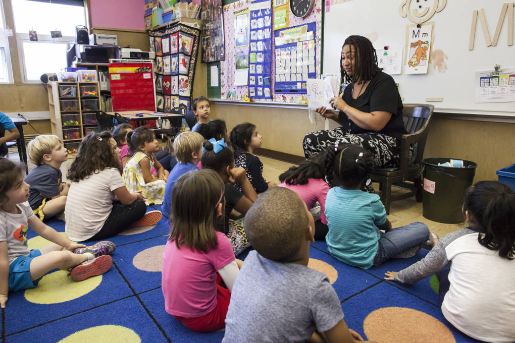 Tontra Love, a T-K (transitional kindergarten) teacher at Sequoia Elementary School in Oakland, reads to her students at the end of class on Tuesday, September 6, 2016.