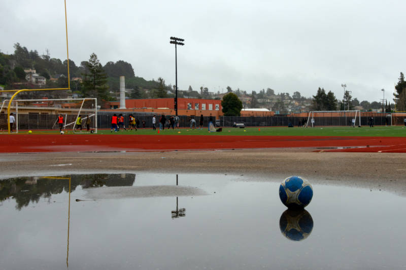 Students at Rudsdale Newcommer High School play soccer on the field they share with Castlemont High School.