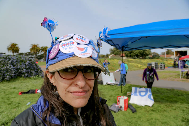 Ena Silva said she worked late last night on crafting her Bernie Sanders buttons and butterfly, flower antennas on her late grandfather's hat.