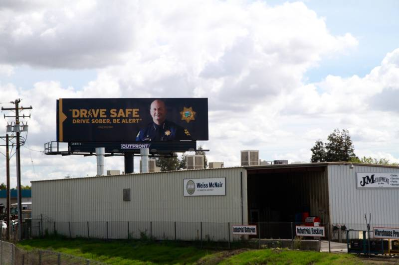 A billboard featuring Fresno Police Chief Jerry Dyer
