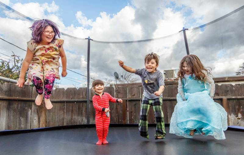 Ayla, 9, Alorra, 3, Aden, 6, Alilith, 5, enjoy the trampoline their mother, Bobbie Allison, recently bought and assembled for them. Allison said she had to leave Merced to find a landlord willing to accept her Section 8 housing voucher. It's far from child care and work in Merced, but in Atwater her children have a backyard where the trampoline and several rescued factory chickens provide the main entertainment.